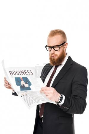 Photo for Handsome young bearded businessman in eyeglasses reading newspaper isolated on white - Royalty Free Image