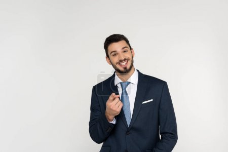 Photo for Cheerful young businessman pointing at camera isolated on grey - Royalty Free Image