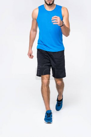 cropped shot of runner jogging on white