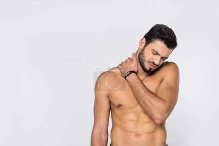 Photo for Young shirtless man with pain in neck isolated on white - Royalty Free Image