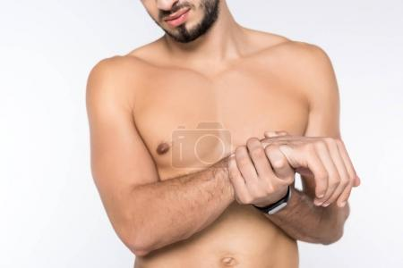 cropped shot of young shirtless man with wrist pain isolated on white