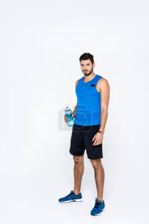 athletic young man with fitness bottle isolated on white