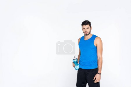 sportive young man with fitness bottle isolated on white