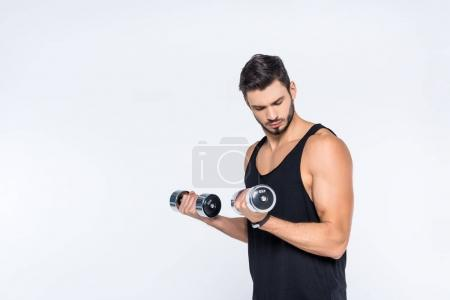 muscular young man working out with dumbbells isolated on white