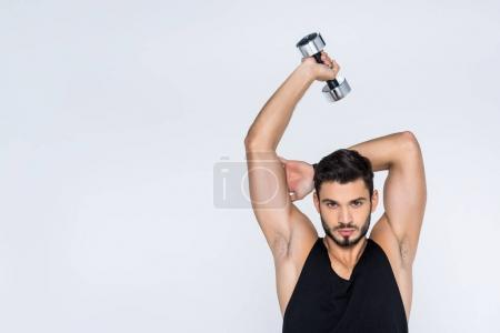 young man working out with dumbbell isolated on white