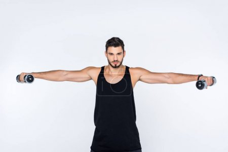 sportive young man working out with dumbbells isolated on white