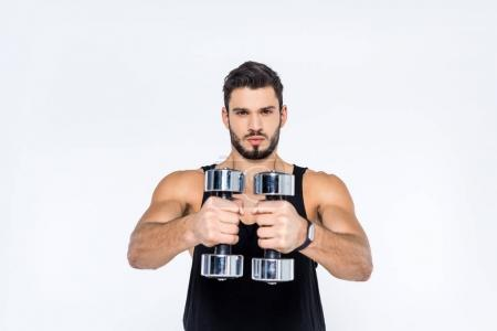 Photo for Athletic young man working out with dumbbells isolated on white - Royalty Free Image