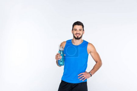 Photo for Smiling young man with fitness bottle isolated on white - Royalty Free Image