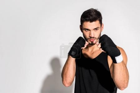 handsome young fighter standing in defence position