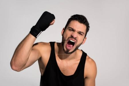angry young fighter screaming at camera