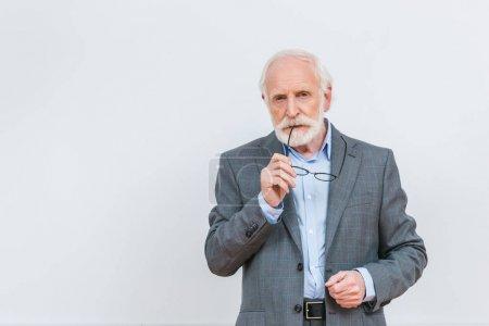senior lecturer biting eyeglasses isolated on white