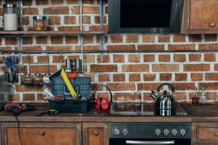 toolbox with various tools and kitchen appliances