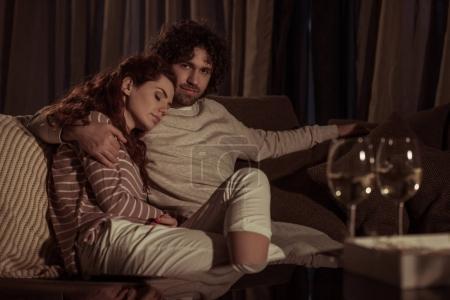 girlfriend sleeping on boyfriend shoulder in evening