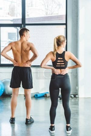 Photo for Back view of couple warming up after workout in gym - Royalty Free Image