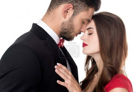 couple with closed eyes touching with foreheads isolated on white