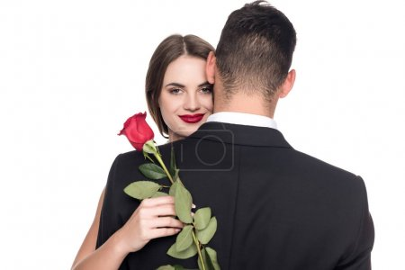 girlfriend hugging boyfriend and holding rose isolated on white, valentines day concept