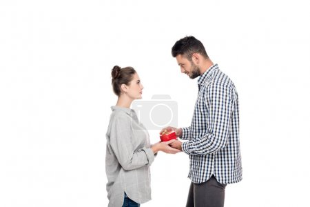 side view of girlfriend giving boyfriend present box isolated on white, valentines day concept
