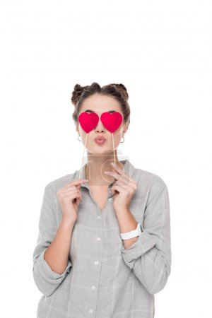 girl covering eyes with paper hearts isolated on white, valentines day concept