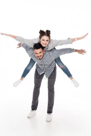 boyfriend giving piggyback to girlfriend with open arms isolated on white