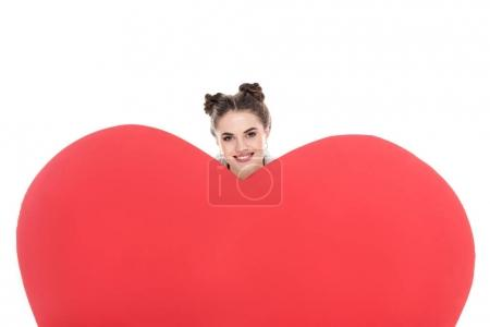 smiling girl looking out from big heart isolated on white, valentines day concept