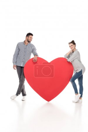 couple leaning on big heart on white, valentines day concept
