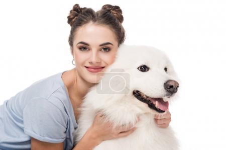 Photo pour Heureux fille étreinte chien isolé sur blanc - image libre de droit