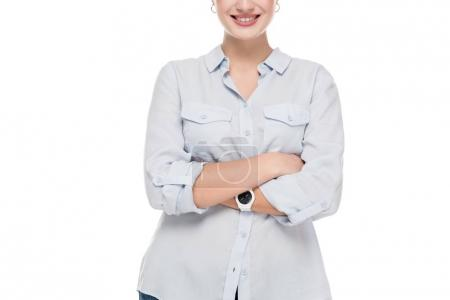cropped image of smiling girl with crossed arms isolated on white