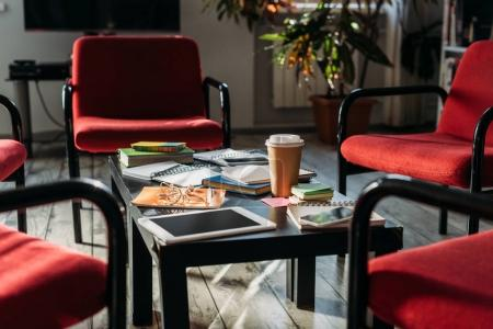 Photo for Digital devices, notebooks and coffee on table at home - Royalty Free Image