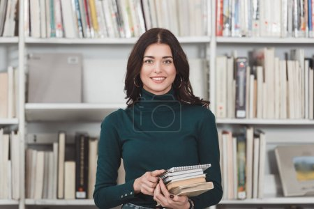 smiling caucasian girl looking at camera in library