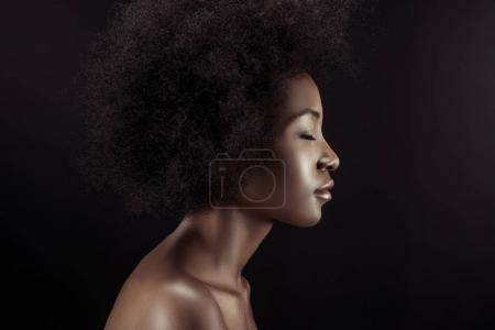 profile of attractive african american woman isolated on black