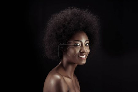 beautiful african american woman looking at camera isolated on black