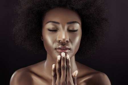beautiful african american woman with closed eyes isolated on black