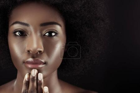 close-up portrait of attractive african american woman isolated on black
