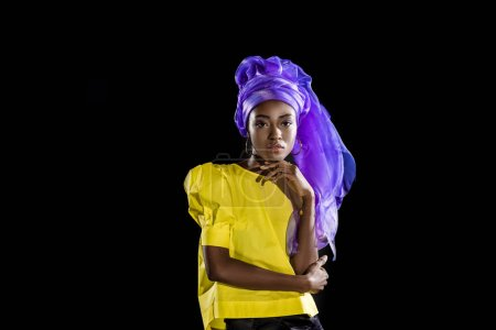 Photo for Attractive young african american woman in stylish retro clothing isolated on black - Royalty Free Image