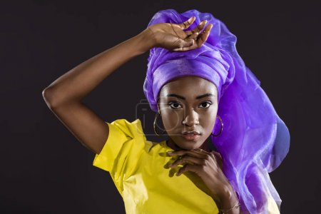Photo for Attractive african american woman in stylish vintage clothing isolated on black - Royalty Free Image