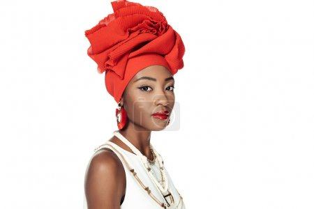 beautiful african american woman in ethnic accessories isolated on white
