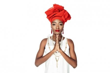 young african american woman making prayer gesture isolated on white