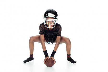 female american football player with ball standing in start position isolated on white