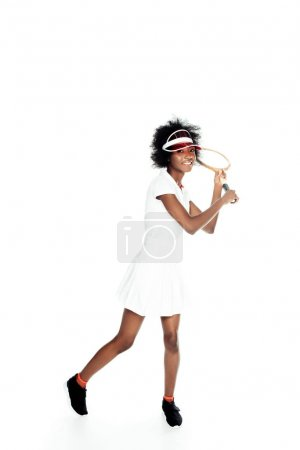 happy young female tennis player preparing to serve isolated on white