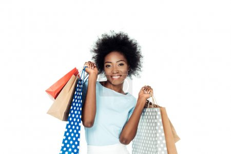 Photo for Happy woman holding various shopping bags isolated on white - Royalty Free Image