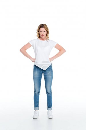 attractive woman standing akimbo isolated on white