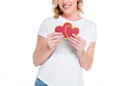 partial view of cheerful woman with heart shaped postcards isolated on white, st valentines day concept