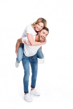excited man piggybacking his girlfriend, isolated on white
