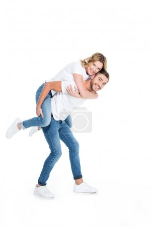 handsome man piggybacking his smiling girlfriend, isolated on white