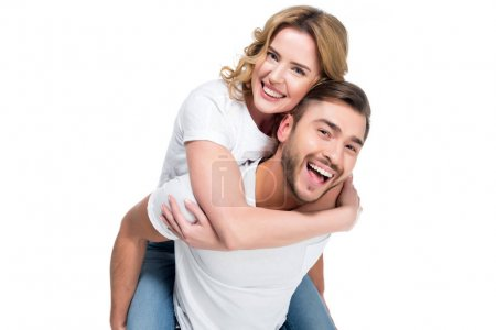 excited man piggybacking his smiling girlfriend, isolated on white
