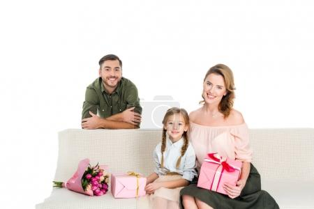 happy family with presents on sofa isolated on white