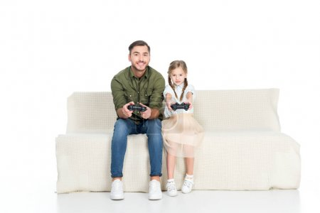 smiling father and daughter playing video game together isolated on white