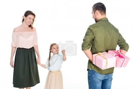 man greeting wife and daughter with holiday isolated on white, international womens day concept