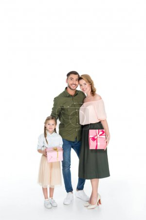 smiling man hugging family with presents isolated on white, international womens day concept