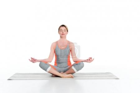 woman in sportswear practicing yoga isolated on white